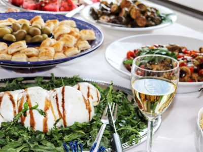 Italian catering buffet with mozzarella, olives and white wine