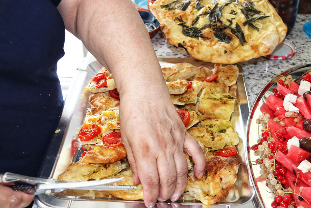 angela carnelutti cutting pizza bread