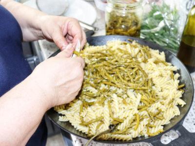 angela carnelutti preparing pasta salad with asparagus
