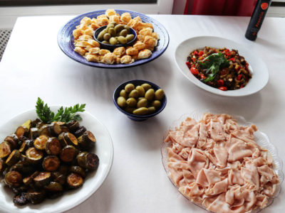 Italian catering buffet with mortadella, olives and red peppers