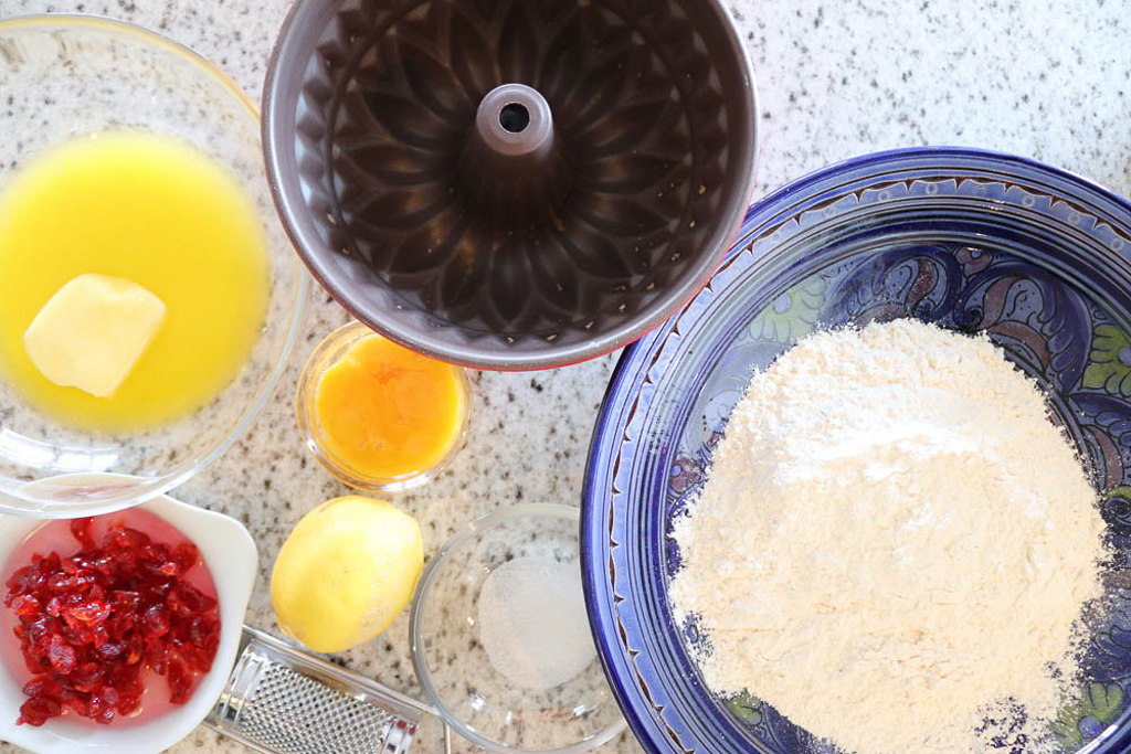 Ingredients for a yeast ring cake with candied cherries